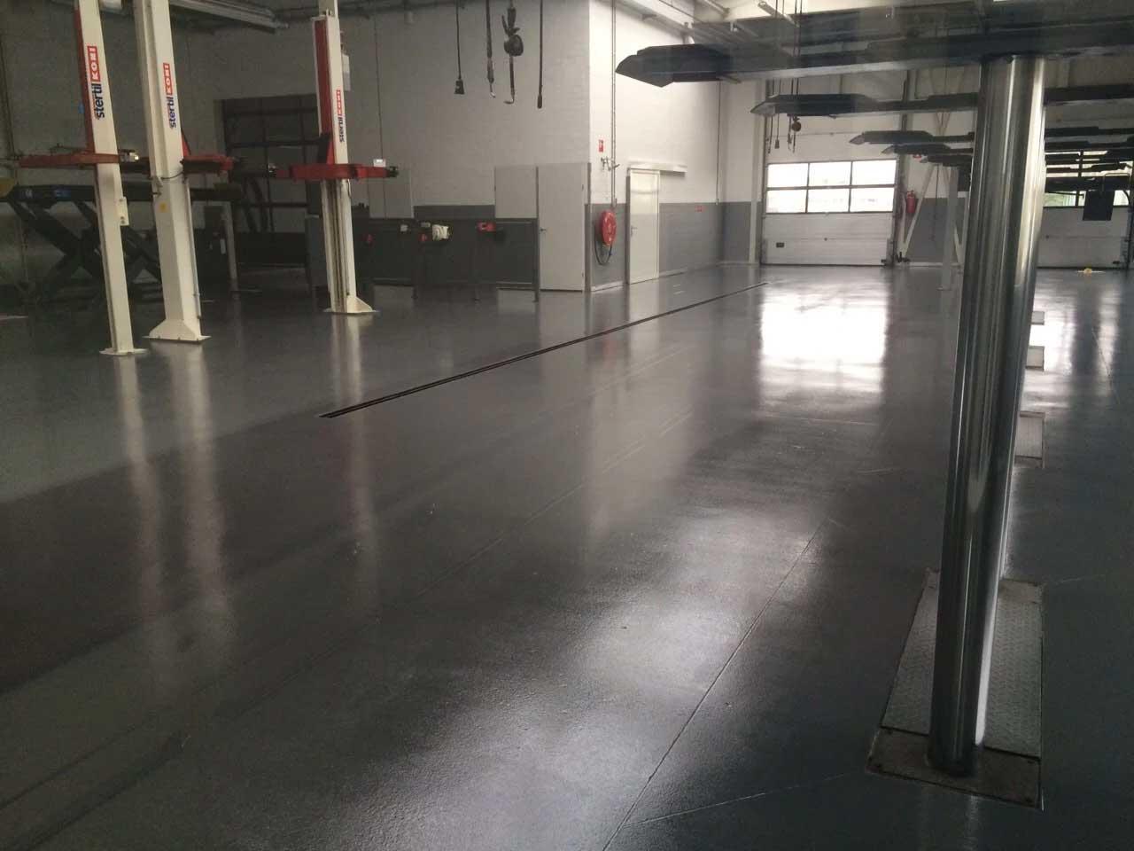 Coated floor car garage